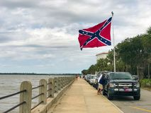 Confederate Flag flying. South Carolina residents drive out to the battery on the peninsula to hoist the confederate flag Stock Photo