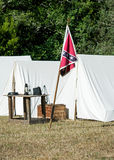 American Civil War Cannon. Confederate flag in front of an American Civil War re-enactment camp Stock Image