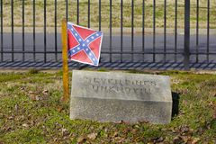 Confederate Flag on Grave of Unknown Soldier Killed at Seven Pines. Rebel flag highlights the grave of an Unknown Soldier killed in the Battle of Seven Pines Stock Images