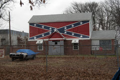 Confederate Flag painted on a house. Southern House with Confederate Flag painted on the side Royalty Free Stock Images