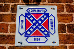Confederate flag plaque attached to brick wall. Confederate flag plaque attached to brick  wall Stock Photos