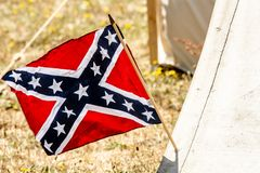 American Civil War confederate flag. Confederate flag on the side of a canvas tent suggesting a civil war confederate camp Stock Photo
