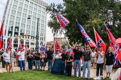 Confederate Flag supporters in South Carolina. Supporters of flying the Confederate Flag gather at the South Carolina State House near the Confederate Soldier Stock Photo