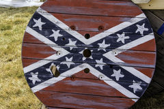 Confederate Flag Table. Confederate flag emblem painted on picnic table Stock Photo