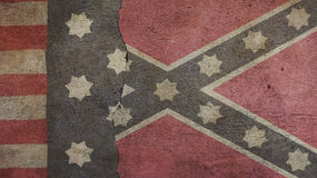 Confederate Flag and Union Flag. On Cracked Concrete Stock Images