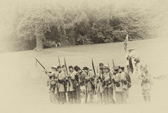 Confederate infantry line firing a volley. Stock Photos