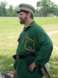 Confederate Man With Green Uniform. Photo of a man dressed as a confederate soldier at the manassas battlefield in virginia on 7/17/10.  This is to celebrate the Royalty Free Stock Photos