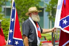 Confederate Memorial Day Participant, South Carolina. Man holding Confederate flag participates in ceremony for Confederate Memorial Day on grounds of the South Royalty Free Stock Photo