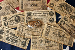Confederate Money. And belt buckle on confederate flag royalty free stock photos