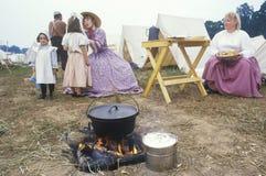 Confederate participants in camp scene Stock Images