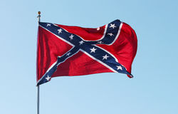 Confederate rebel flag. Waving in the wind against the blue sky background in Charleston, South Carolina, USA Stock Images