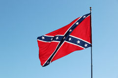 Confederate rebel flag. Waving in the wind against the blue sky background in Charleston, South Carolina, USA Royalty Free Stock Images