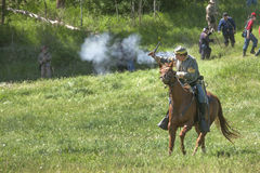 Confederate reenactor on horse shooting. Royalty Free Stock Image