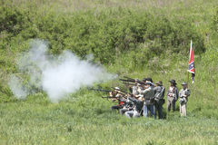 Confederate reenactors shooting their rifles. Stock Photography