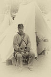 A Confederate sergeant waits by his tent before battle, Royalty Free Stock Image