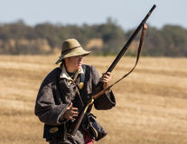 Confederate Soldier. A young Confederate soldier  moves up towards the front lines  during  a Civil War  reenactment at Hawes Farm in Anderson, California on Royalty Free Stock Photos