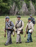 Confederate Soldiers. Civil War era soldiers move up to the front lines at the Dog Island reenactment in Red Bluff, California Stock Image