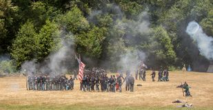 Confederate soldiers fire canon Royalty Free Stock Photography