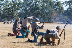Confederate Soldiers. Young Confederate soldiers  aim and reload   during  a Civil War  reenactment at Hawes Farm in Anderson, California on October 4, 2015 Royalty Free Stock Images
