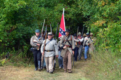 Confederate  troops on the march. Confederate  troops march into battle. well a reenactment one anyways! at the holland civil war muster in holland michigan Stock Photography