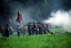 Confederates volley fire on advancing Union soldiers, royalty free stock photo