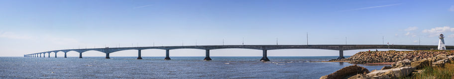 Confederation Bridge panorama, PEI Canada. Panoramic view of Confederation Bridge with Borden-Carleton lighthouse from Prince Edward Island, Canada Royalty Free Stock Image