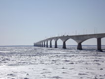 Confederation Bridge in winter. Confederation Bridge from the Prince Edward Island side with ice floes in winter Royalty Free Stock Photography