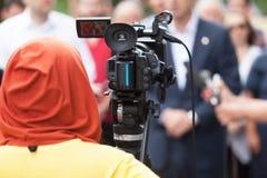 Conferência de imprensa camerawoman Foto de Stock