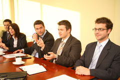 Conference. Five business persons in suits sitting at a conference table, taking part in a meeting and/or presentation royalty free stock photos