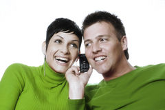 Conference call. Young couple is sharing a mobile while they are talking with their friends