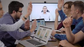 Conference call. The development team communicates with the customer through conference calls. Video calling provides stock video