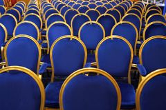 Conference chairs. Interior of conference hall with blue velvet chairs stock photo