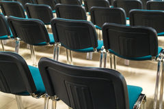 Conference chairs in business room, rows of comfortable seats in empty corporate presentation meeting office, detail, selective fo Royalty Free Stock Photos