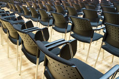 Conference chairs in business room, rows of comfortable seats in empty corporate presentation meeting office, detail, selective fo Stock Images