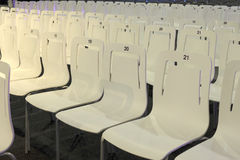Conference chairs with numbers in a row Stock Images