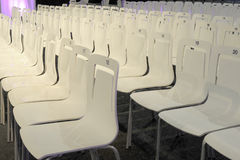 Conference charis in a row with numbers Royalty Free Stock Photos
