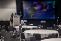 Conference concert room with mic for public speaking and performance. Portrait of a microphone in a conference room stock photography