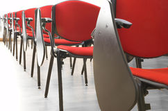 Conference hall #2. Red chairs rows in conference hall Royalty Free Stock Photo