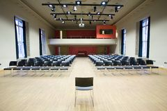 Conference hall. Blank conference room with lots of chairs Stock Images