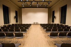 Conference hall. Modern big conference hall with big screen Stock Photos
