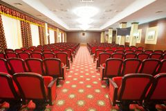 Conference hall. Big conference hall with numerous chairs Royalty Free Stock Photos