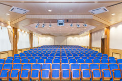 Conference hall with blue seats Stock Photos