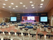 The conference hall getting ready for the 2nd Business Partners Meet of HAL Helicopter Division, Bangalore. The conference hall at a popular Convention centre Stock Image