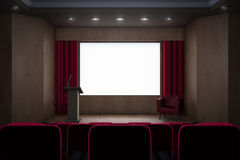 Conference hall with lights off. And screen on Stock Image