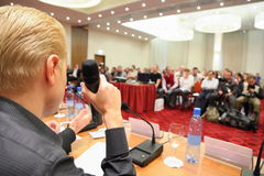 Conference in hall. man with microphone. Stock Photography