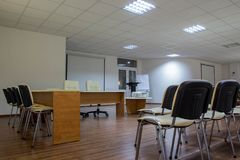Conference hall for meeting with companions. Conference room for negotiations with business partners, conducting trainings, discussing ideas Royalty Free Stock Photo