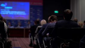 Conference hall. People listen to the presentation. stock footage