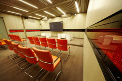 Conference hall with red armchairs Royalty Free Stock Image