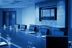 Conference hall with screen, monochromatic royalty free stock photography
