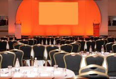 Conference hall with stage. A view of an empty conference room with a stage set up Royalty Free Stock Image